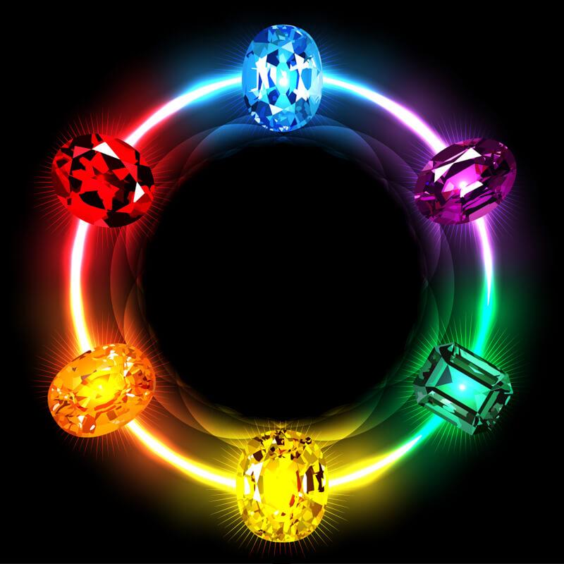 Картинка с разноцветным кругом и кристаллами на чёрном фоне.