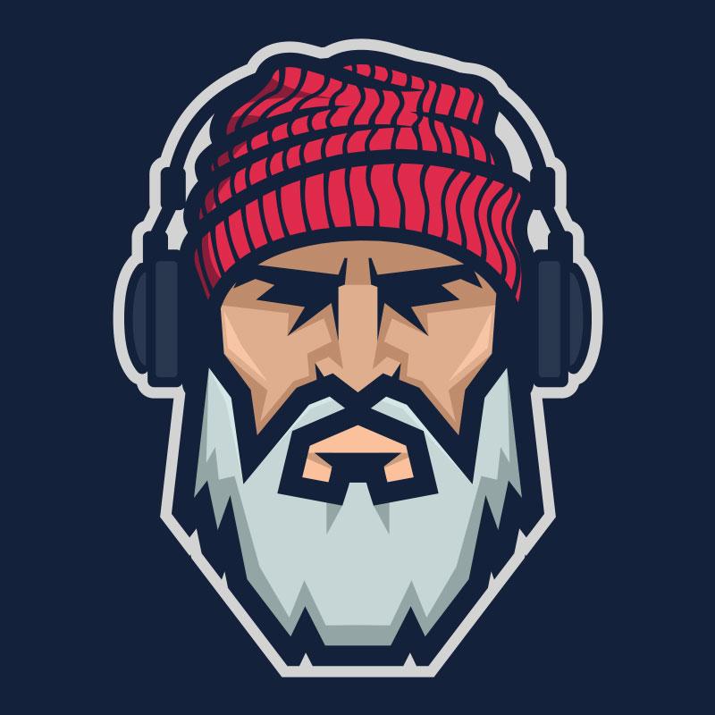 Голова бородача в красной вязанной шапке и наушниках.